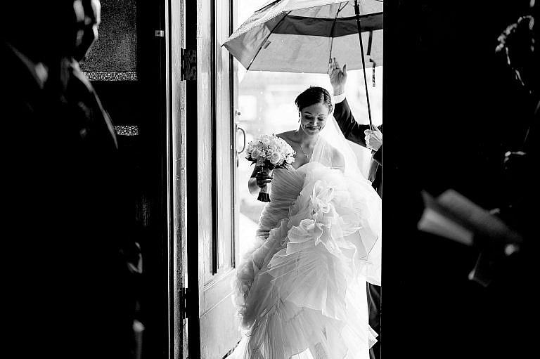 B&W Bride Entering Church in Rain-175