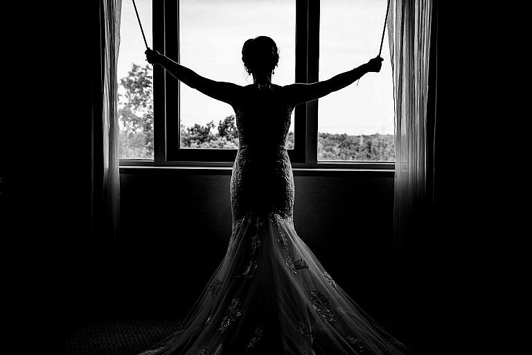 B&W Bride Opening Blinds
